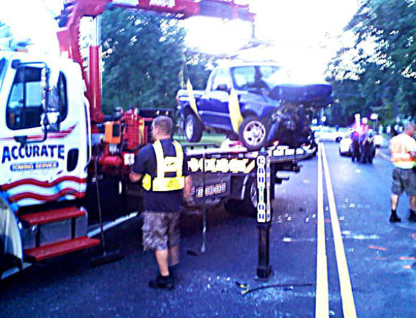 FATAL RECOVERY/TRUCK LIFTED AND ROTATED ONTO  FLATBED